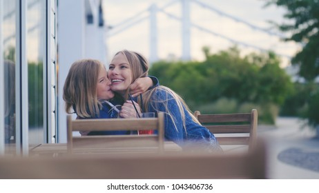 Young hugging mother and daughter outdoors