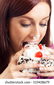 Young hungry gluttonous woman eating pie, isolated on white background. Healthy eating and dieting concept studio shot.