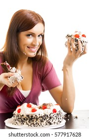 Young hungry gluttonous woman eating pie, isolated on white background