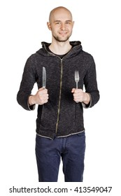 Young  hungry man holding cutlery fork and knife on hand. diet, food, healthy, style concept. isolated on a white studio background.