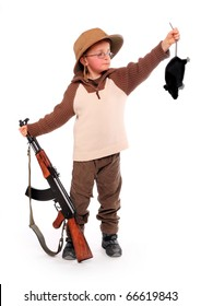 The young hunter dressed on a safari suit with rifle holding big rat. Funny image ready for your calendar.