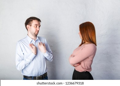 young husband is deceiving his wife, his wife looks at him reproachfully and does not believe him. Family problems concept
