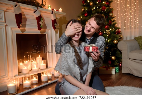 Young Husband Making Surprise Present His Stock Photo (Edit