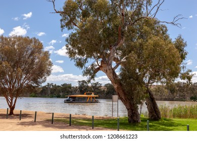 Young Husband, South Australia - Nov 7 2012: A modern houseboat on the Murray River in South Australia. Houseboat holidays on the river are very popular with Australians.