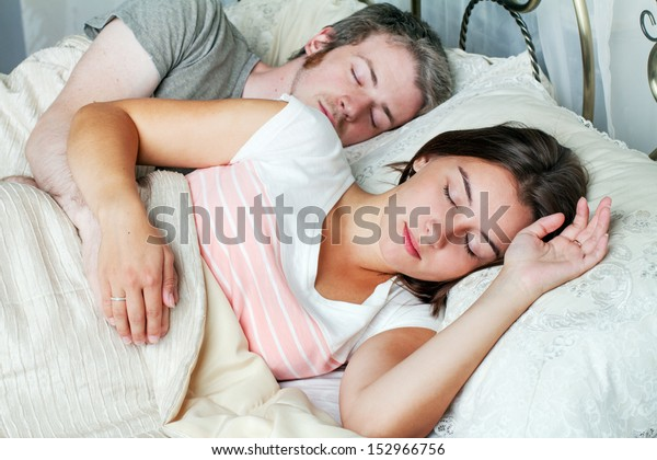 . Young Husband Wife Sleeping On Bed Stock Photo  Edit Now  152966756
