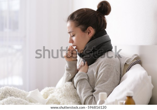 Young ill woman in bed at home