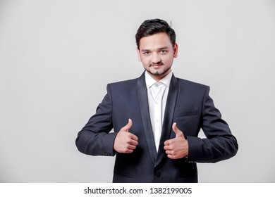 Young Indian / Asian businessman in suit