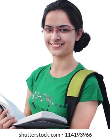 Young Indian / Asian college student reading book, on a white isolated background.