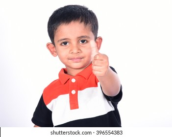Young Indian boy giving the thumbs up