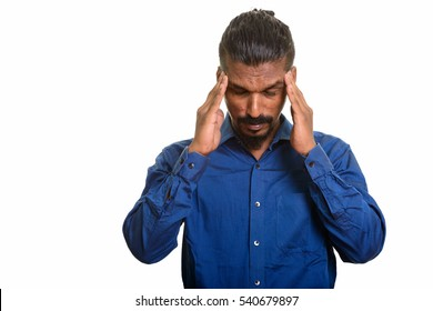 Young Indian businessman having headache isolated against white background