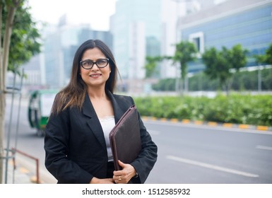 Young Indian businesswoman with a file in city