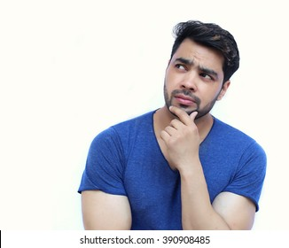 Young Indian Confused Man Scratching His Chin - isolated white background