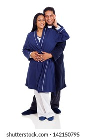 young indian couple in pajamas embracing isolated on white