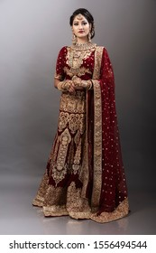Young Indian female in ethnic Indian wear celebrating festival of Diwali