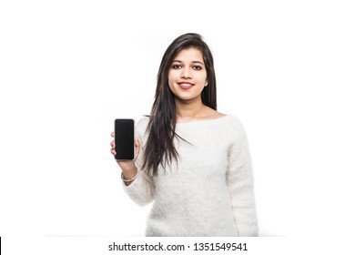 Young Indian girl hold mobile phone screen for copy space isolated on a white background