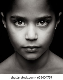 Young Indian girl looking at the camera in black and white