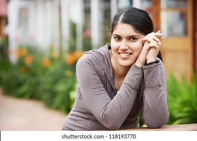 Young indian girl student happy smiling portrait outdoors