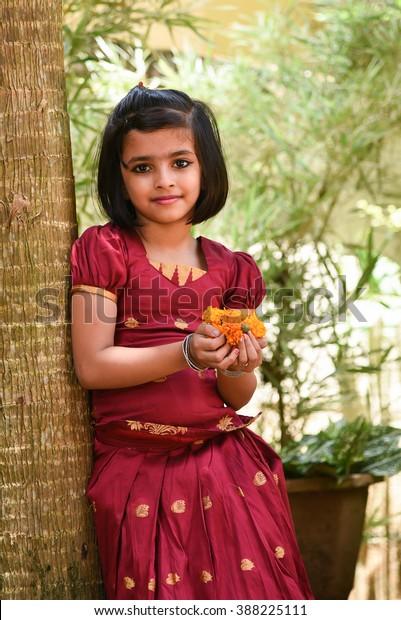 12ea2f468d young Indian girl wearing traditional dress for Onam, Vishu Kerala India .  Asian child.