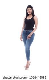 Young Indian lady in Black camisole and Blue jeans. A life style shot