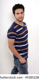 young Indian male model in blue tshirt side pose