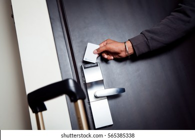 Young Indian Man Unlocking His Hotel Room