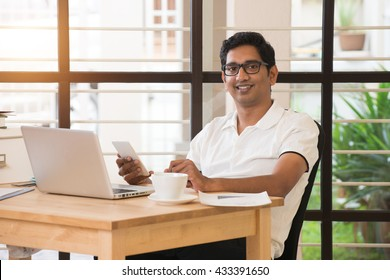 young indian man working from home office