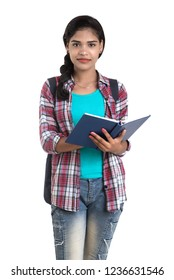 young Indian woman with backpack standing and holding notebooks, posing on a white background.