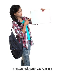 young Indian woman with backpack standing and holding white board, posing on a white background.