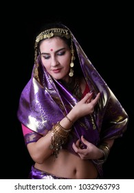 Young Indian woman dancer in traditional clothes portrait on black background. Exotic Asian beauty