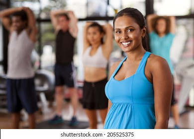 Young Indian woman in a gym preparing to exercise