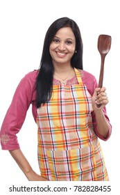Young Indian woman holding spatula