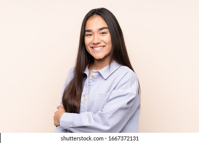 Young Indian woman isolated on beige background laughing