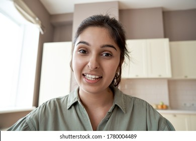 Young indian woman online teacher, counselor, remote tutor or job applicant speaking looking at web cam giving online training, virtual class lesson, video call interview. Webcam view face headshot.