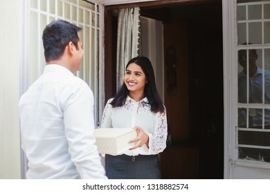 Young Indian woman receiving delivery package