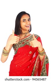Young Indian woman in traditional clothing with a thumbs up.