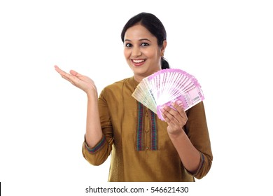 Young Indian woman with two thousand rupee notes in her hands