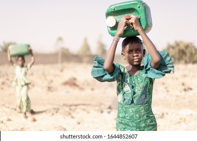 Young Indigenous Young Girl Carrying fresh Water in a typical village