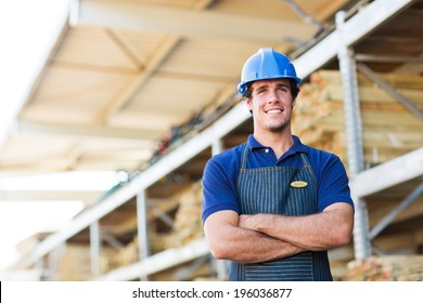 young industrial worker with arms crossed