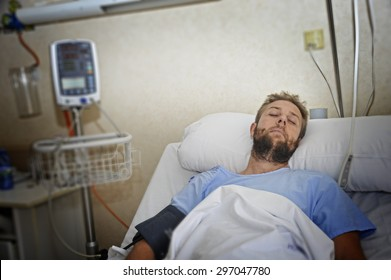 young injured man lying in bed hospital room resting from pain looking in bad health condition after suffering accident in health care concept