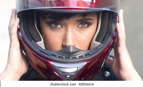 Young Intense Girl in Red Full Face Motorcycle Helmet