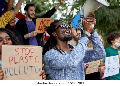 young international demonstration participants protesting against climate policy, want to be heard by government, they hold colourful placards in hands