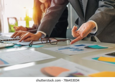 Young investor work with new startup project in office. businesswoman with colleague using touchpad present. Creative discussion corporate work Concept