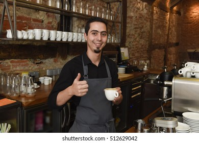 young italian barista or coffee maker at restaurant shop preparing delicious milk cream at cafe machine in professional staff worker concept