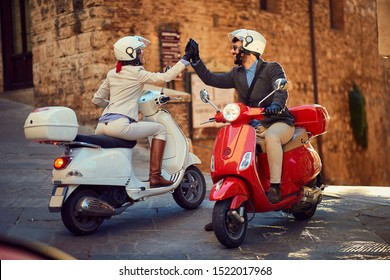 Young Italian Couple on Vespa Scooter. Bikers couple.