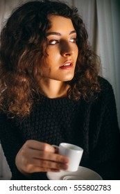 Young italian girl drinking coffee and waiting for something special