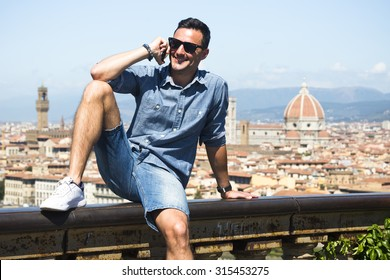The young italian man use his phone in Firenze