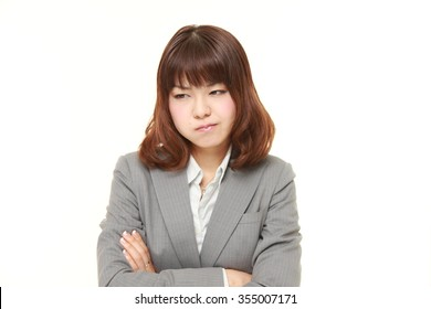 young Japanese businesswoman in a bad mood