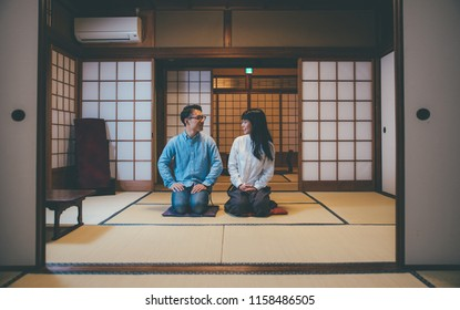 Young japanese couple spending time in their house