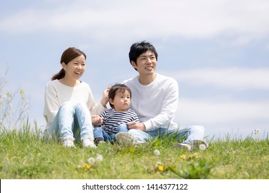 Young Japanese Family Parenting in the Park