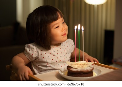 Young Japanese girl celebrating her third birthday.